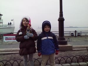 Battery Park. Views of a tiny Statue of Liberty.