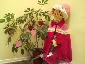Meet Rosie. She's our scarecrow that we got on clearance two years. She sits in the hall outside our door. We decided that we liked her so much that we keep her out all year long and dress her up for each holiday/season. The kids say hi and bye to her each day.