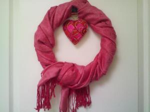 Valentine's wreath on our door made from a scarf wrapped on a round frame.