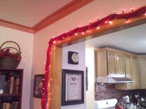 Valentine's garland made with red Christmas lights wrapped around one of my babywearing wraps.