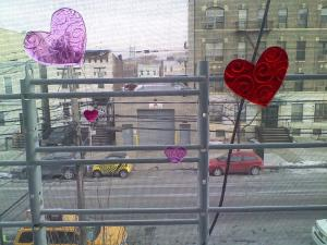 Sticky hearts from the .99 Cent store in the window - It's Valentine's Day NYC!