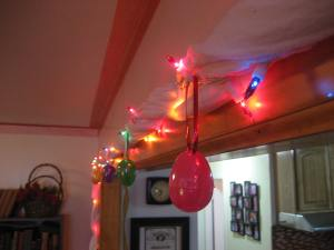 Easter eggs dangle from the lights. I used Christmas ribbon and poked it through the holes in the eggs to make loops to hang them from.