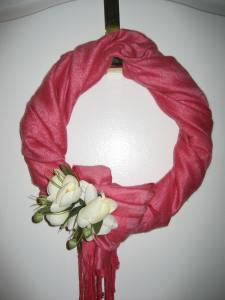 The Valentine wreath (a wire frame wrapped with a scarf) becomes the Easter wreath with clip of a flower. I'll switch it to a spring wreath later by adding a yellow ribbon.