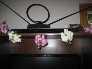 Lilies that I had from somewhere clipped on to a ribbon graces the entertainment center.