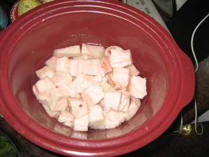 Pork fat in crock pot - ready to cook.